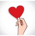 Heart shape sticker in hand vector image