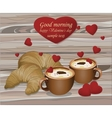 Two coffee cups and croisants on wood background vector image