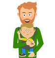 young father holding his son in baby carrier vector image