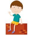 Boy on the wall waving hand vector image