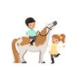 cheerful little boy jockey sitting on pony horse vector image