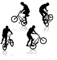 Set silhouette of a cyclist male performing vector image