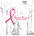 Ribbon of Breast Cancer on abstract wooden vector image