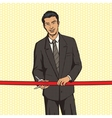 Man cuts red ribbon pop art style vector image