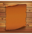Old orange scroll on wooden planks vector image