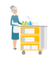 senior chambermaid pushing cart with bed clothes vector image vector image
