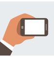 Businessman holding mobile phone vector image