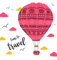 hot air balloon with ornaments in cloudy sky vector image