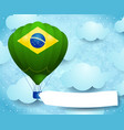 hot air balloon with brazilian colors and banner vector image