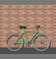 bike in front of brick wall vector image