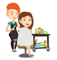 Hairdresser making haircut to young woman vector image