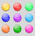 audio cassette icon sign symbol on nine wavy vector image
