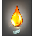 golden drop of oil on a gray background vector image vector image