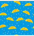 Umbrellas and raindrops seamless background vector image