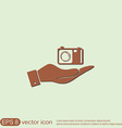hand holding a photo camera vector image