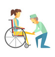 male doctor helping woman sitting on wheelchair vector image