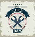 Colorful emblem of happy labor day with crossed vector image