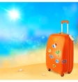 Luggage with traveling stickers at sunny beach vector image vector image
