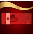 A red banner with heart suspended on a chain to vector image