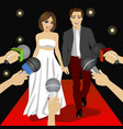 Fashionable couple on a red carpet event vector image