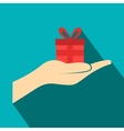 Small gift red box in a hand flat icon vector image