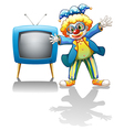 A clown beside a blue television vector image vector image