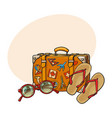 Flip flops sunglasses suitcase with tourist vector image