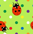 Seamless ladybugs over green background vector image