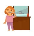 little redhead girl brushes her teeth near vector image