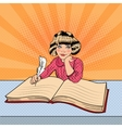Pop Art Little Girl Writing in Big Book vector image