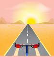 cyclist riding through a desert landscape towards vector image