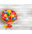Easter background with color easter eggs in basket vector image