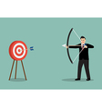 Businessman hitting the target vector image