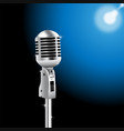 retro microphone on spotlight background vector image