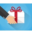 Hand carrying a gift box vector image