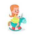 sweet little redhead girl playing blue rocking vector image