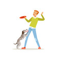 cheerful red-haired man playing with his dog guy vector image