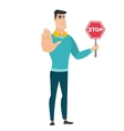 Caucasian businessman holding stop road sign vector image