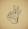 Hand draw sketch vintage okay hand sign vector image