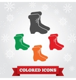 Boots icon Winter holiday Christmas symbol vector image