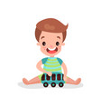 sweet little boy sitting on the floor playing with vector image