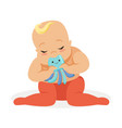 adorable baby sitting and playing with octopus vector image