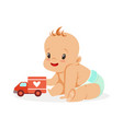 sweet happy baby sitting and playing with toy car vector image