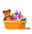 Fluffy teddy bear and rubber chicken toys in box vector image