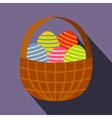 Colorful easter eggs in the basket flat icon vector image