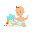 sweet smiling baby in a diaper playing with toy vector image