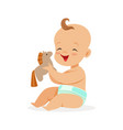 adorable happy baby in a diaper sitting and vector image