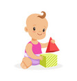 sweet smiling baby sitting and playing with toy vector image