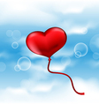 Balloon in the shape of heart on blue sky vector image vector image