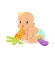 Adorable baby in a diaper sitting and playing with vector image
